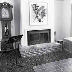 Black-and-white image of the living room fireplace at Mt. San Angelo
