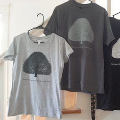 Black, charcoal, and gray t-shirts featuring a tree
