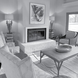 black and white photo of fireplace in living room